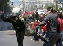 Policeman kicking a protester during an anti-austerity demonstration in Athens in May 2010. (Photo by Milos Bicanski /Getty Images)