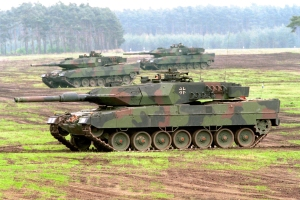 German-made tanks taking part in a military training exercise Photo credit: Bundeswehr-Fotos Creative Commons licence CC BY 2.0