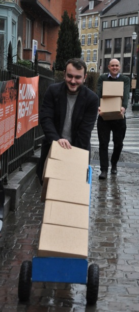 26 boxes containing 1000 copies of the English language version of Building Peace Togetherarrive at Quaker House Brussels. Photo: Kate McNally